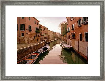 Sunset Along The Canals Of Venice Framed Print by Cliff Wassmann