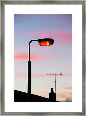 Sunset And A Street Light In Ambleside Framed Print by Ashley Cooper
