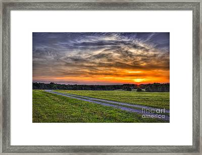 Sunset And The Road Home Framed Print by Reid Callaway