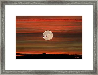 Sunset Flight With Full Moon Framed Print by Donna Kennedy