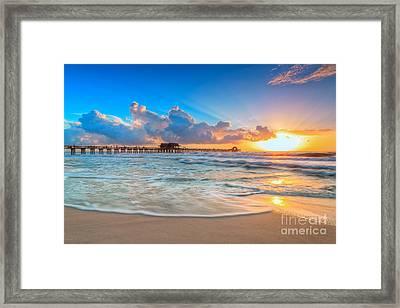 Sunset Naples Pier Framed Print by Hans J Leschmann