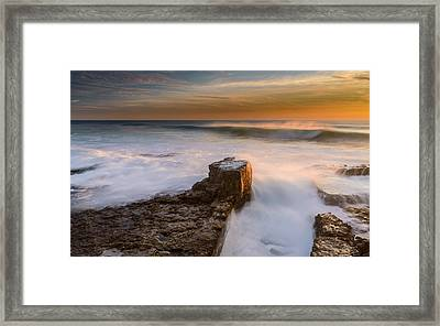 Sunset Over A Rough Sea II Framed Print by Marco Oliveira