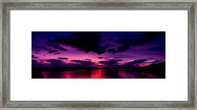 Sunset Over An Island Viewed Framed Print by Panoramic Images