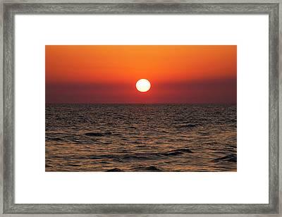 Sunset Over The Ocean Framed Print by Jim Edds