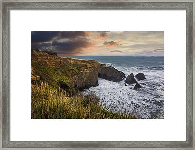 Sunset Over The Oregon Coast Framed Print by Debra and Dave Vanderlaan