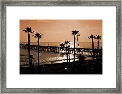 Sunset Over The Pacific Framed Print by Ann van Breemen