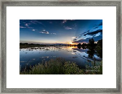Sunset Over The River Framed Print by Steven Reed