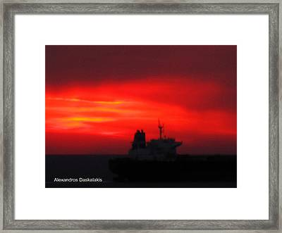 Sunset Over The Ship Framed Print by Alexandros Daskalakis