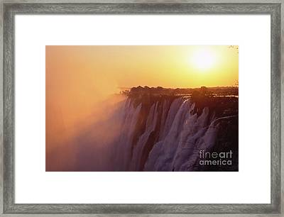 Sunset Over The Victoria Falls Framed Print by Alex Cassels