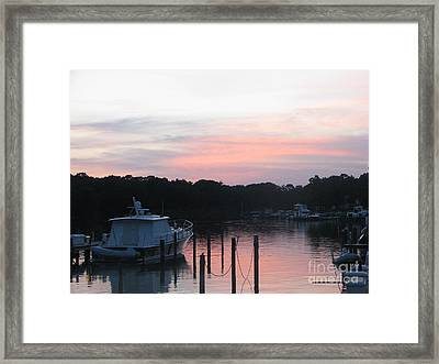 Sunset Over The Waters  Framed Print by John Morris