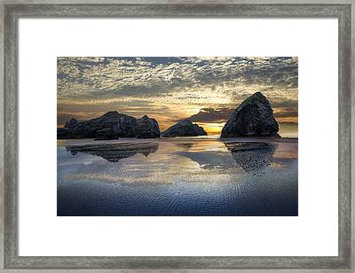 Sunset Stacks Framed Print by Debra and Dave Vanderlaan