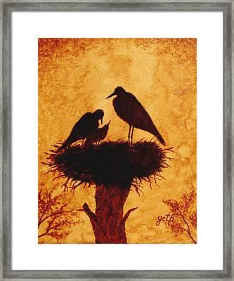 Sunset Stork Family Silhouettes Framed Print by Georgeta  Blanaru