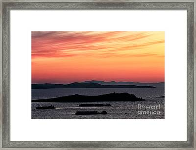 Sunset Streaks In The Sky At Mykonos Framed Print by John Rizzuto