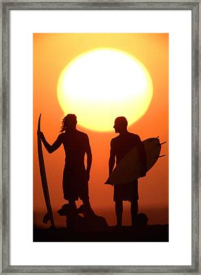 Sunset Surfers Framed Print by Sean Davey