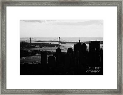 sunset view of manhattan financial district new york bay and Verrazano Narrows Bridge Framed Print by Joe Fox