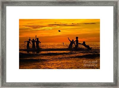 Sunset Water Football Framed Print by Anne Kitzman