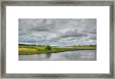Sunshine And Heavy Clouds Over Dennisport Framed Print by Michelle Wiarda