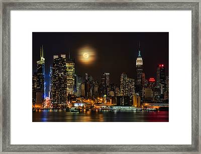 Super Moon Over Nyc Framed Print by Susan Candelario