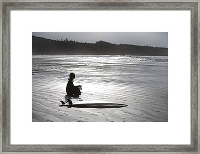 Surfer Meditating On Beach, Cox Bay Framed Print by Deddeda