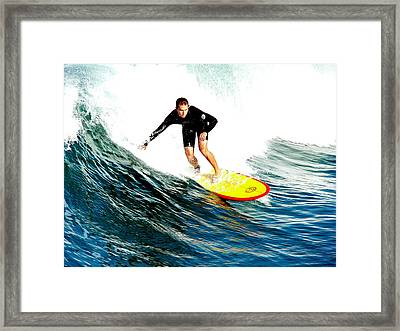 Surfer Riding Wave Framed Print by Jeff Lowe