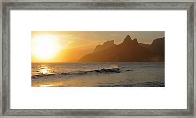 Surfers At Sunset On Ipanema Beach, Rio Framed Print by Panoramic Images