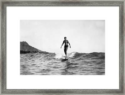 Surfing At Waikiki Beach Framed Print by Underwood Archives