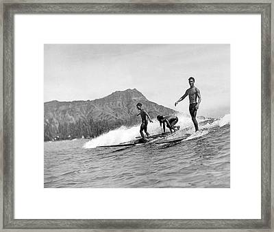 Surfing In Honolulu Framed Print by Underwood Archives