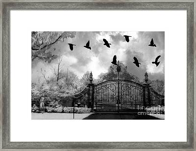 Surreal Gothic Black And White Gate With Flying Ravens  Framed Print by Kathy Fornal