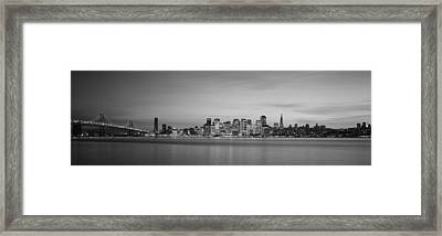 Suspension Bridge With City Skyline Framed Print by Panoramic Images