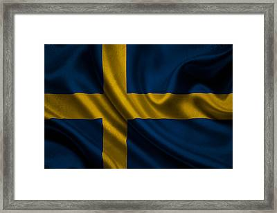 Swedish Flag Waving On Canvas Framed Print by Eti Reid
