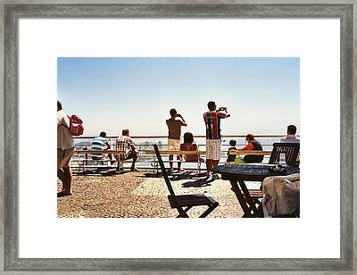 Taking Pictures Framed Print by M N
