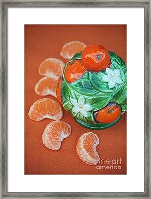 Tangerine Slices And Ceramics Framed Print by Luv Photography