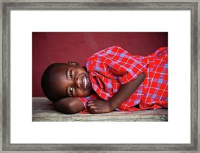 Tanzanian Boy Smiling Framed Print by Matthew Oldfield