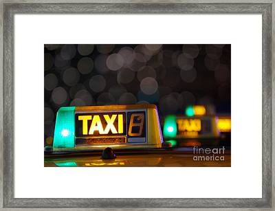 Taxi Signs Framed Print by Carlos Caetano