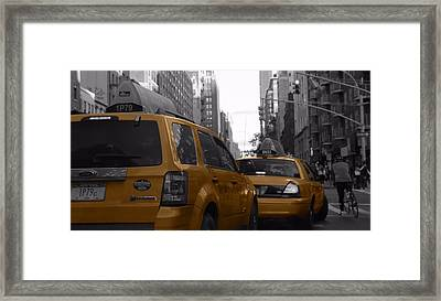 Taxis And Bikes In New York City Framed Print by Dan Sproul