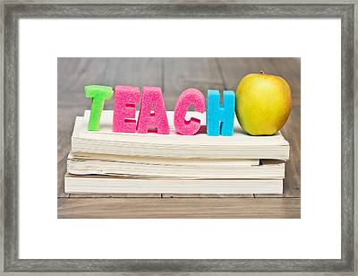 Teach Concept Framed Print by Tom Gowanlock