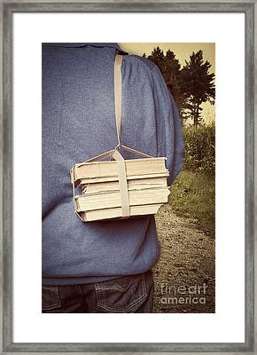 Teen Boy's Back With Books Framed Print by Edward Fielding