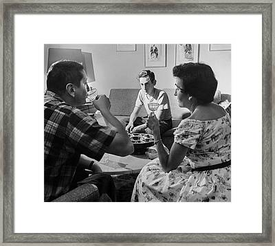 Teen Watches Parents Drink Framed Print by Underwood Archives