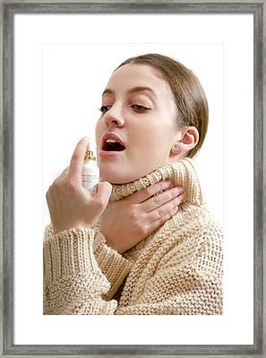 Teenage Girl Using Throat Spray Framed Print by Lea Paterson
