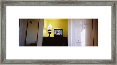 Television And Lamp In A Hotel Room Framed Print by Panoramic Images