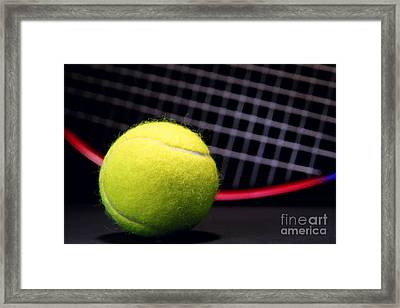 Tennis Ball And Racket Framed Print by Olivier Le Queinec