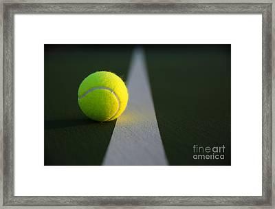 Tennis Ball At Last Light Framed Print by David Lee