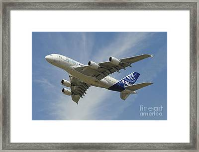 The Airbus A380 Prototype In Flight Framed Print by Riccardo Niccoli