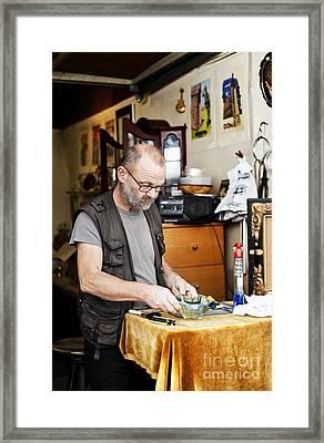 The Antique Dealer Framed Print by Ivy Ho