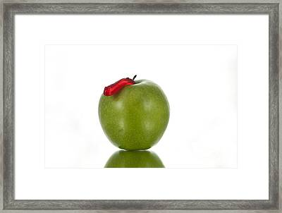 The Apple And The Worm Framed Print by Juli Scalzi