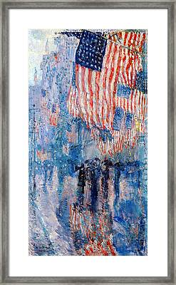 The Avenue In The Rain Framed Print by Frederick Childe Hassam