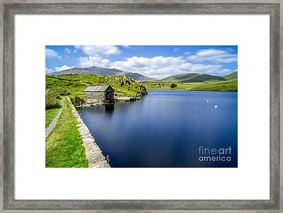 The Boathouse Framed Print by Adrian Evans