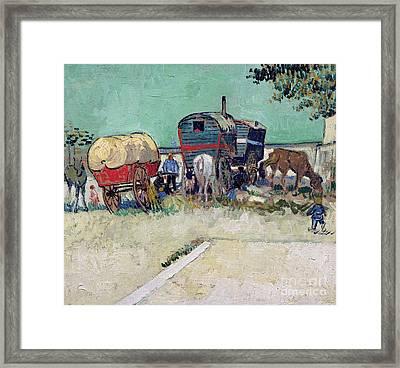 The Caravans   Gypsy Encampment Near Arles Framed Print by Vincent Van Gogh
