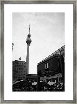 the christmas market in Alexanderplatz with the Berlin Fernsehturm and U-bahn sign Germany Framed Print by Joe Fox