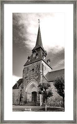 The Church With The Dormers On The Steeple Framed Print by Olivier Le Queinec